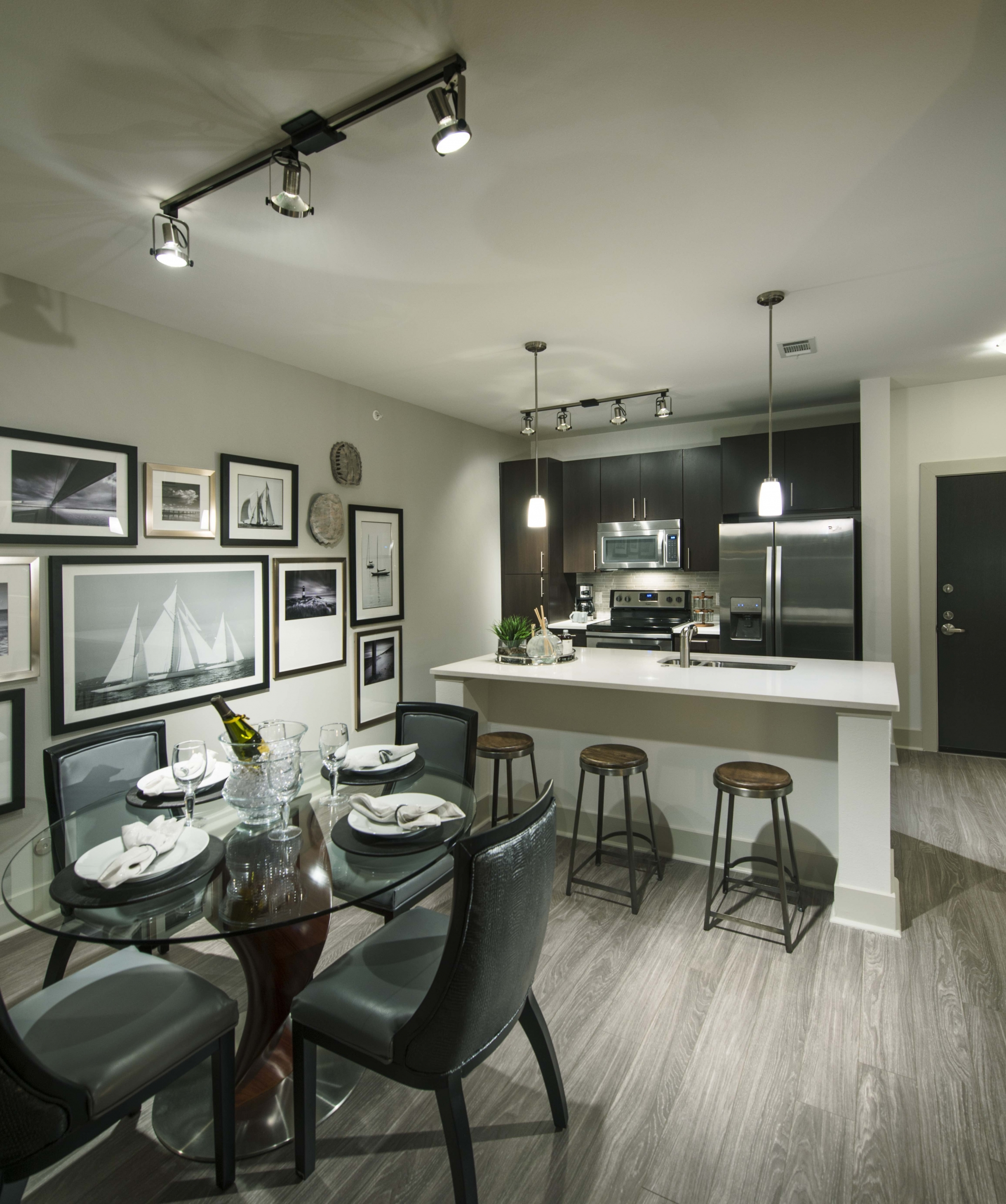 Image of Espresso cabinetry with stone backsplashes for Viridian Design District