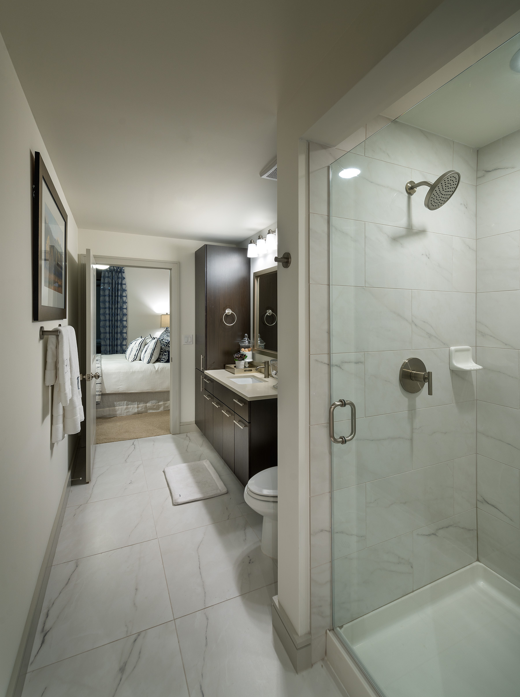 Image of Spa-inspired bathrooms with dual vanities and frameless showers for Hanover Montrose