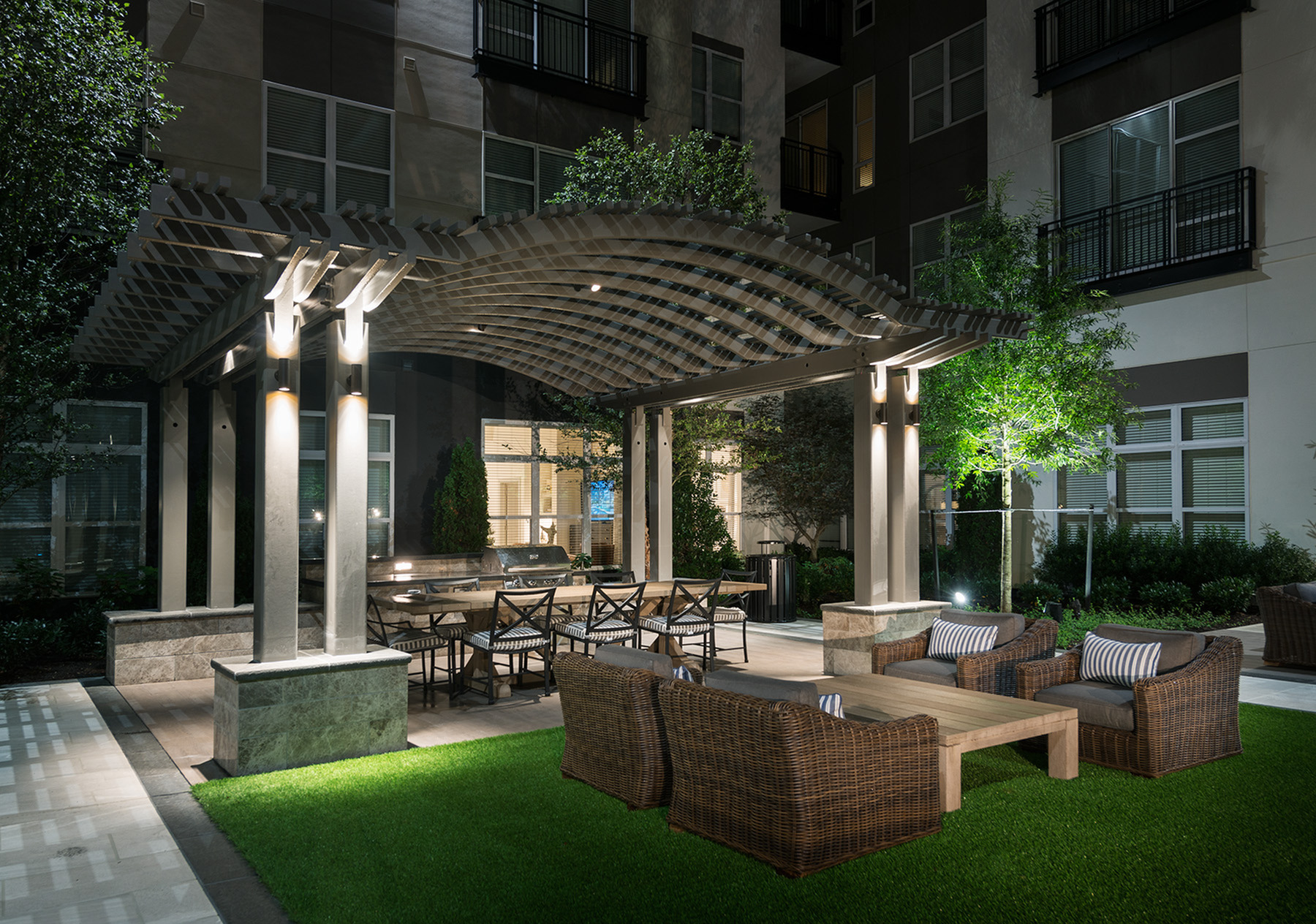 Image of Lush landscaping, grilling and dining areas with social spaces for gathering for Hanover Cross Street