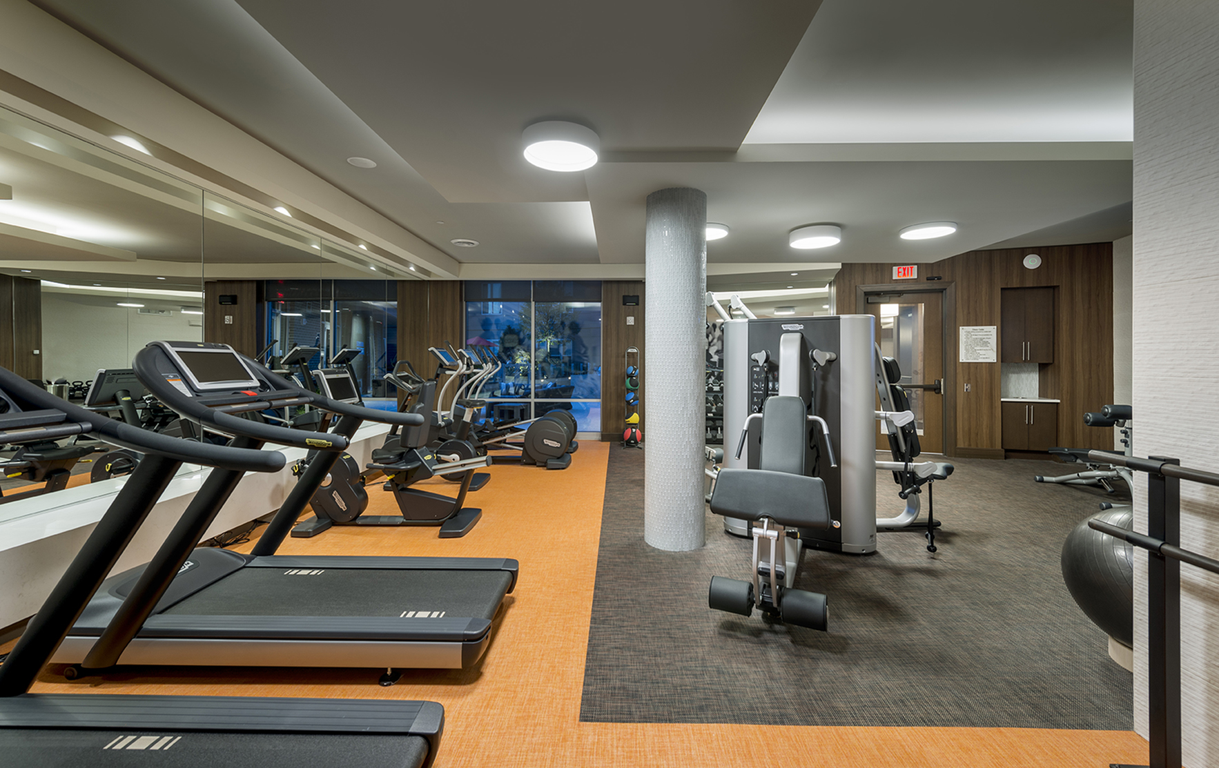 Image of 24/Hr Fitness center with tablet-integrated cardio machines & ballet barre for Hanover Alewife