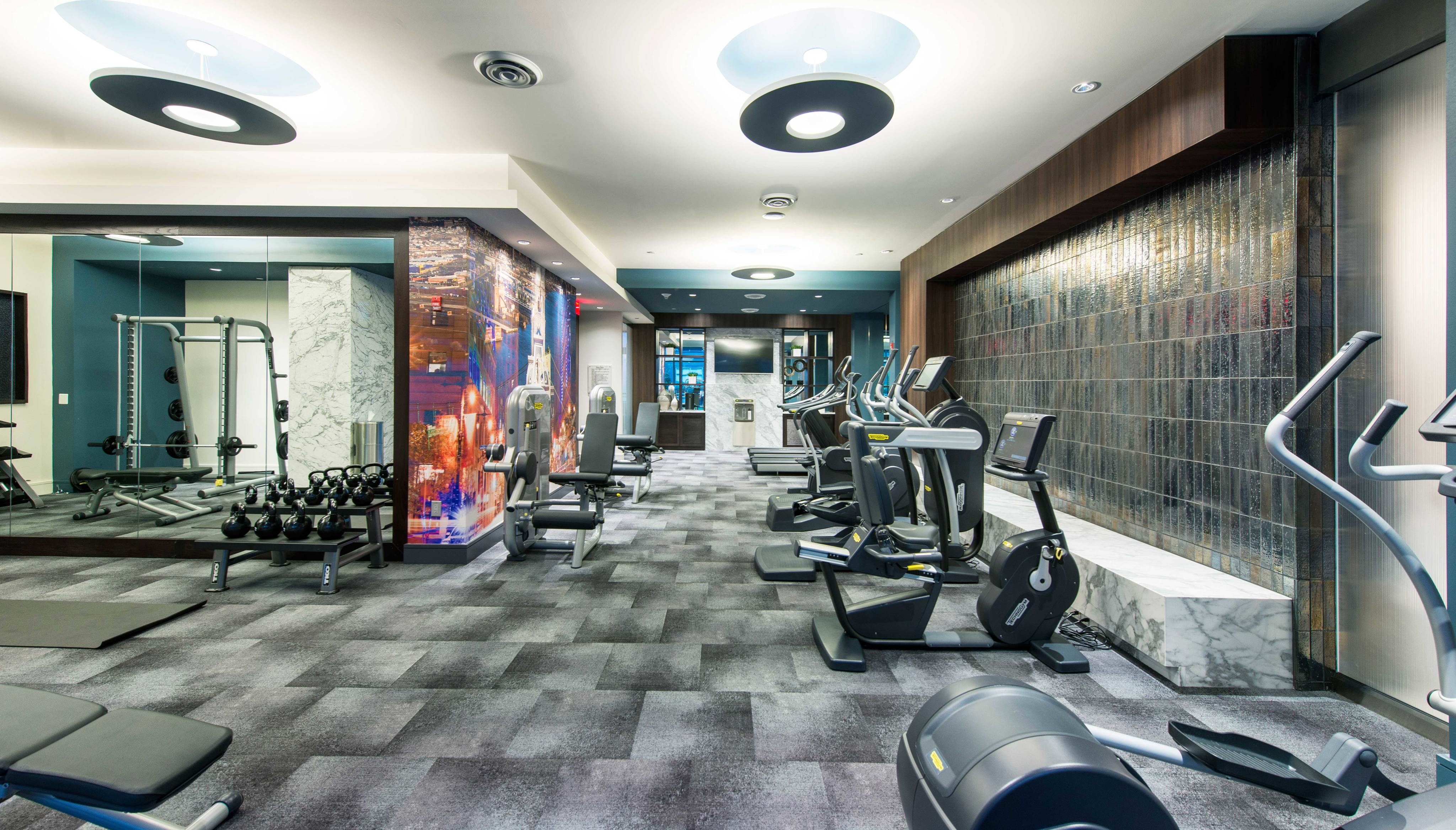 On-site 24-hour fitness with tablet-integrated cardio machines at Hanover North Broad