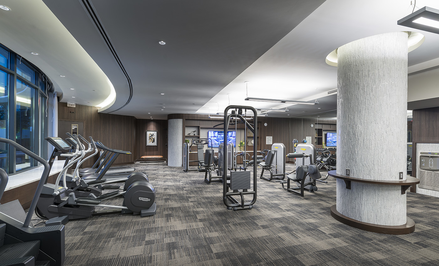 Image of 24-Hour Fitness center with tablet integrated cardio equipment for Hanover Buckhead Village