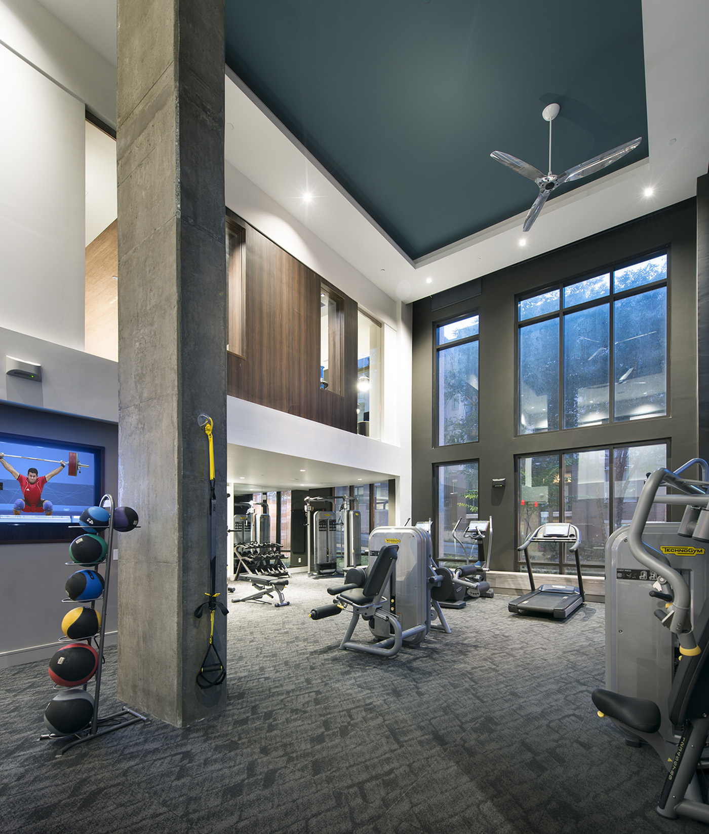 Image of On-site 24-hour fitness center with tablet-integrated cardio machines for Hanover Perimeter