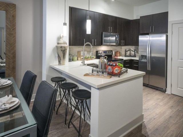 Image of Gourmet chef kitchens with stainless steel appliances for Hanover Northgate