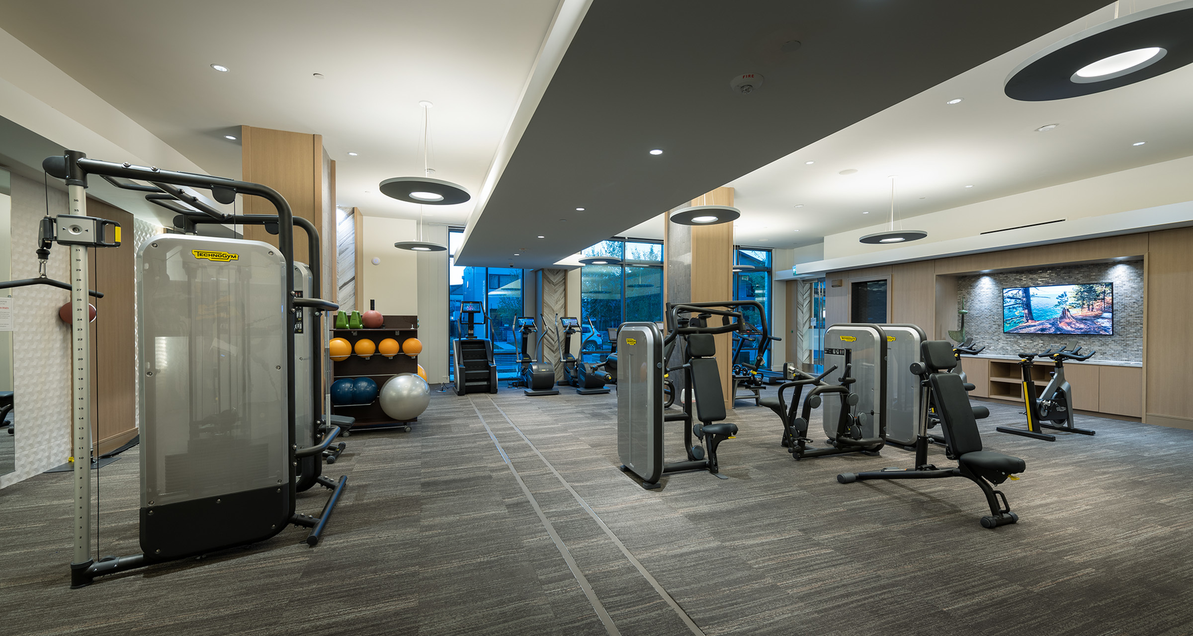 Image of State-of-the-art fitness center with tablet-integrated cardio machines available 24/7 for Hanover Platt Park