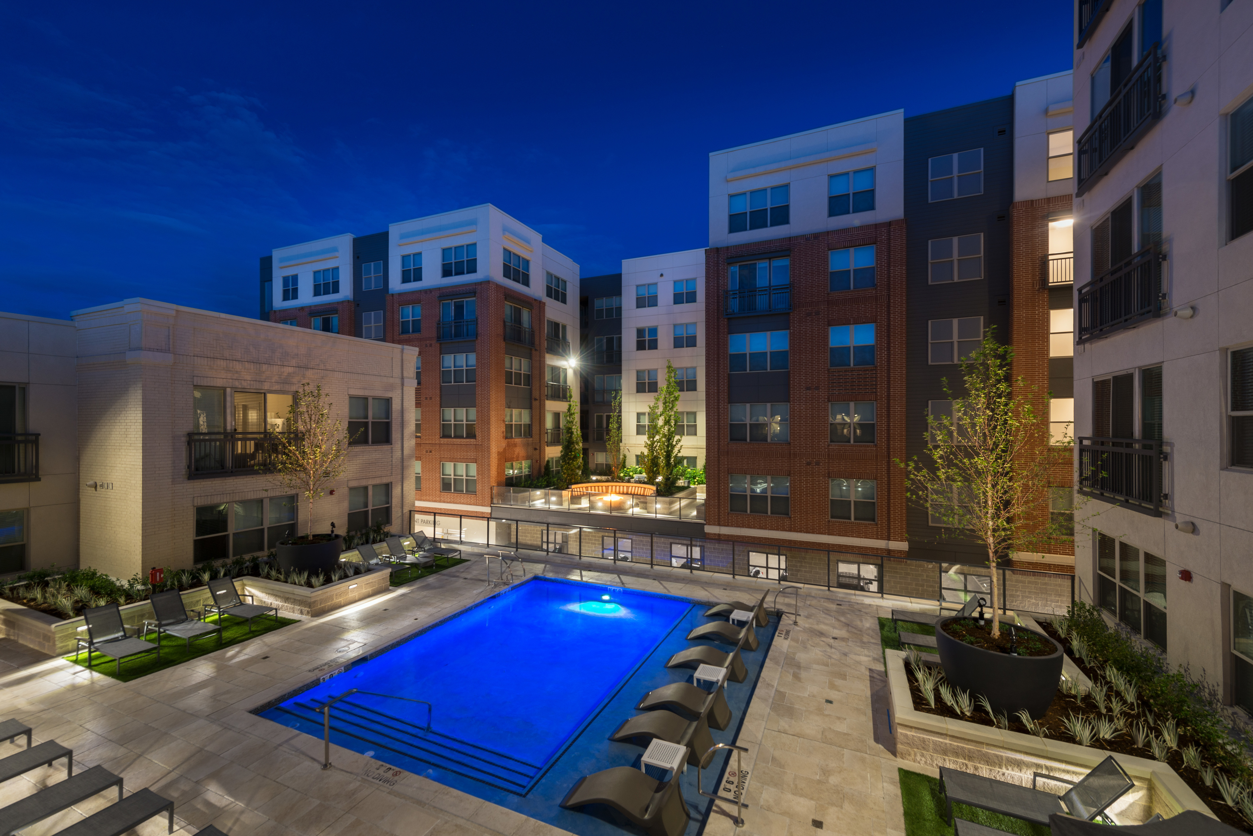 Image of Resort-style outdoor pool with spa deck and in-pool lounging for Hanover Platt Park