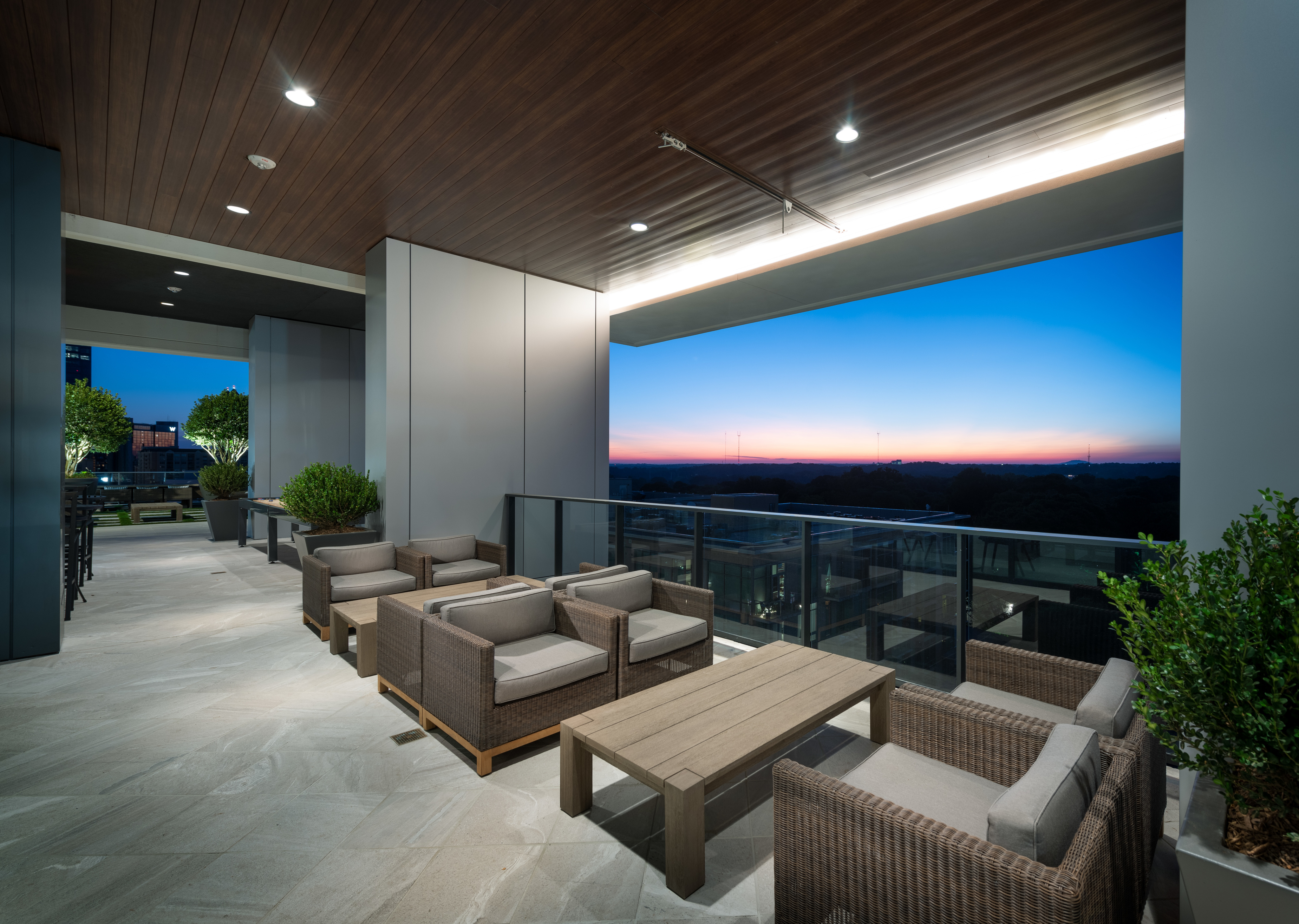 Image of Open-Air Loggia with Lounge Seating and Shuffleboard for Hanover Midtown