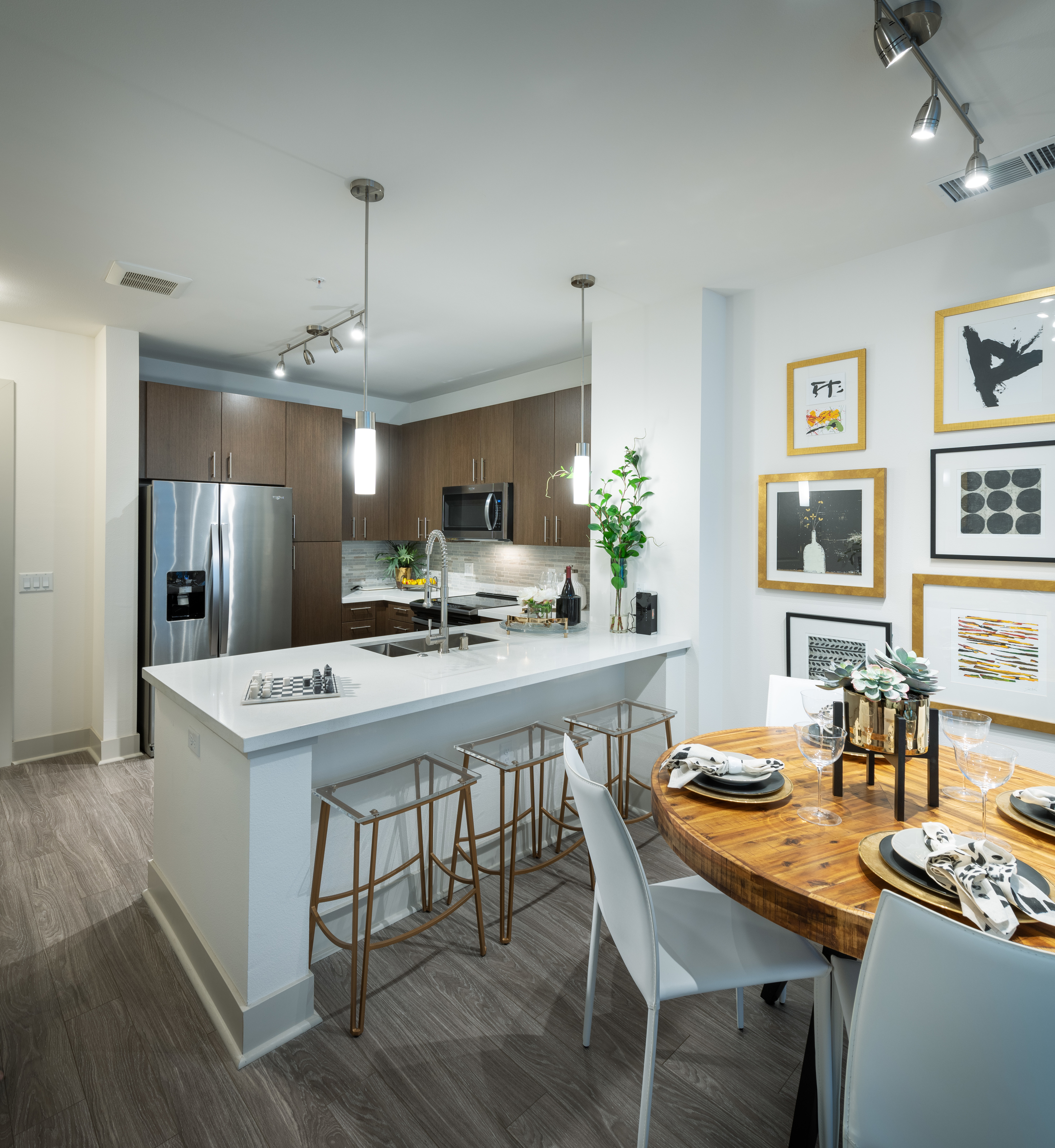 Image of Gourmet chef kitchens with stainless steel appliances for Hanover Broadway