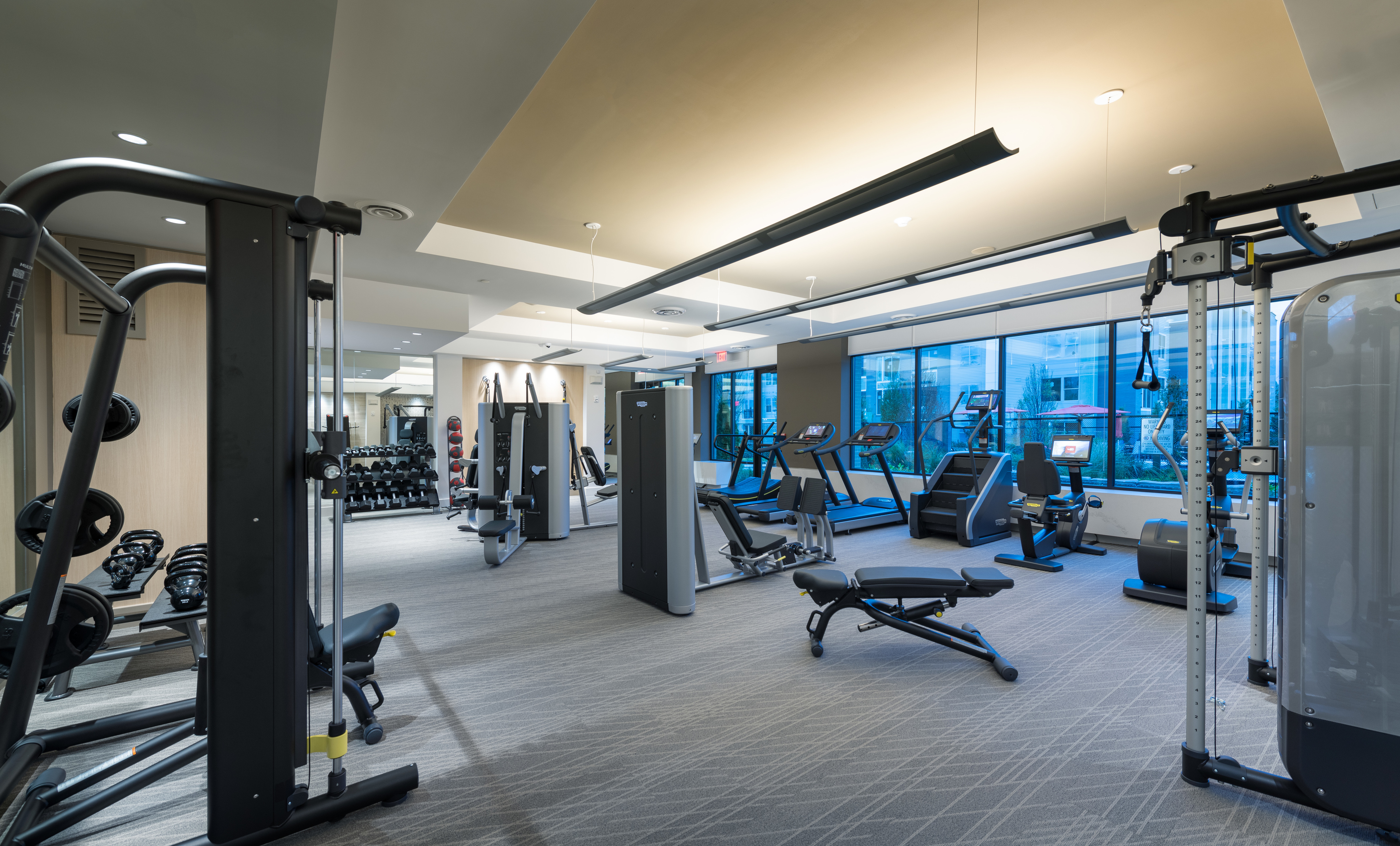 24-hour fitness center with TechnoGym cardio & strength equipment, Peloton On-Demand and yoga stretch space at Hanover Westford Valley