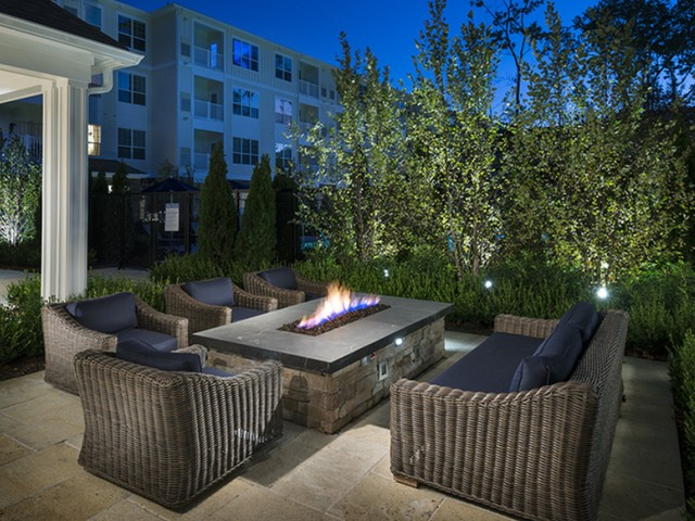 Spacious Resident Lawn with Double-Sided Fireplace, Outdoor Seating, Grilling and Dining Areas at Hanover Westford Hills