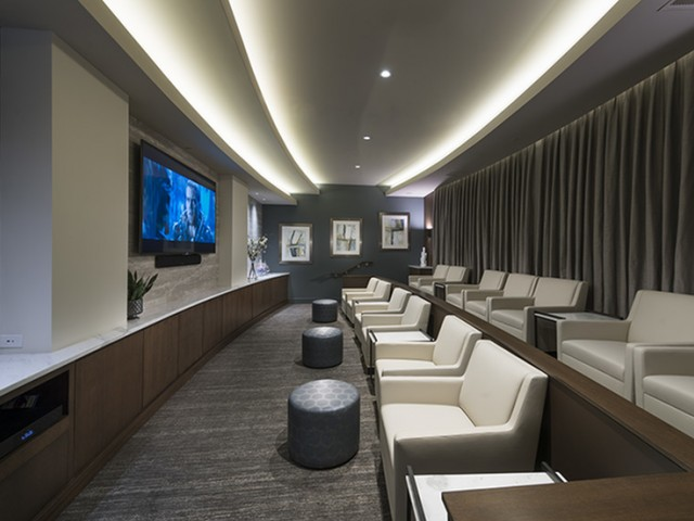 Private Media Room Featuring Surround-Sound and Theater-Style Seating at Hanover Westford Hills