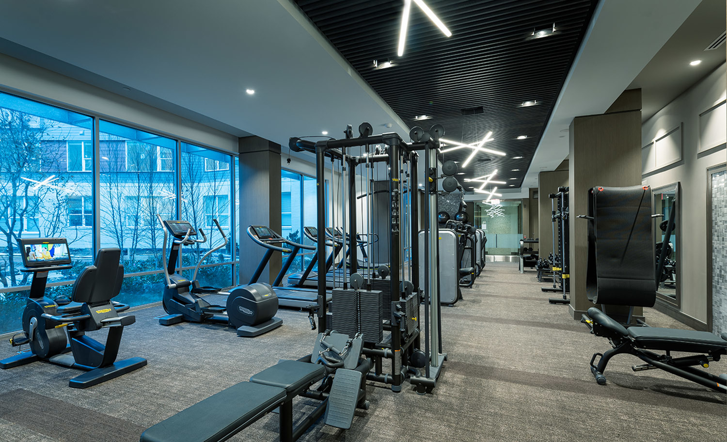 Expansive 24-hour Fitness Center with TechnoGym, TRX, and Peloton On-Demand Bikes at Hanover Town Center