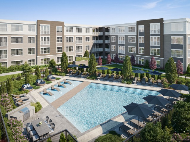 Resort-Style Pool with Outdoor Dining and Poolside Seating at Hanover Westford Hills