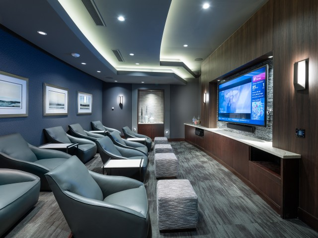 Private Media Room Featuring Surround-Sound and Theater-Style Seating