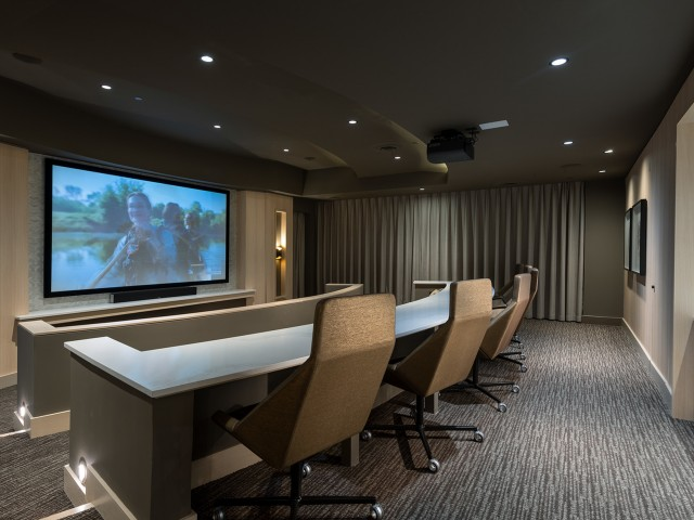 Private Media Room Featuring an Impressive HD Projector and Theater-Style Seating