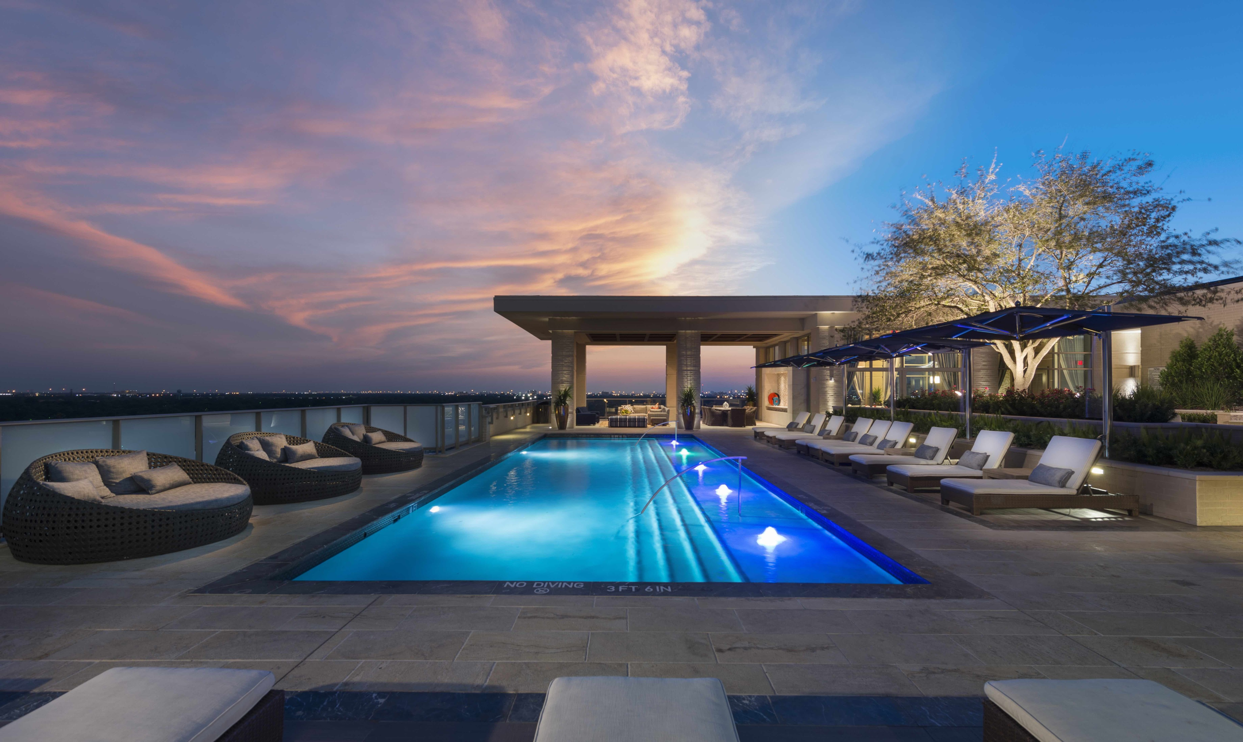 Rooftop pool with sunbeds and poolside cabanas at Hanover Southampton