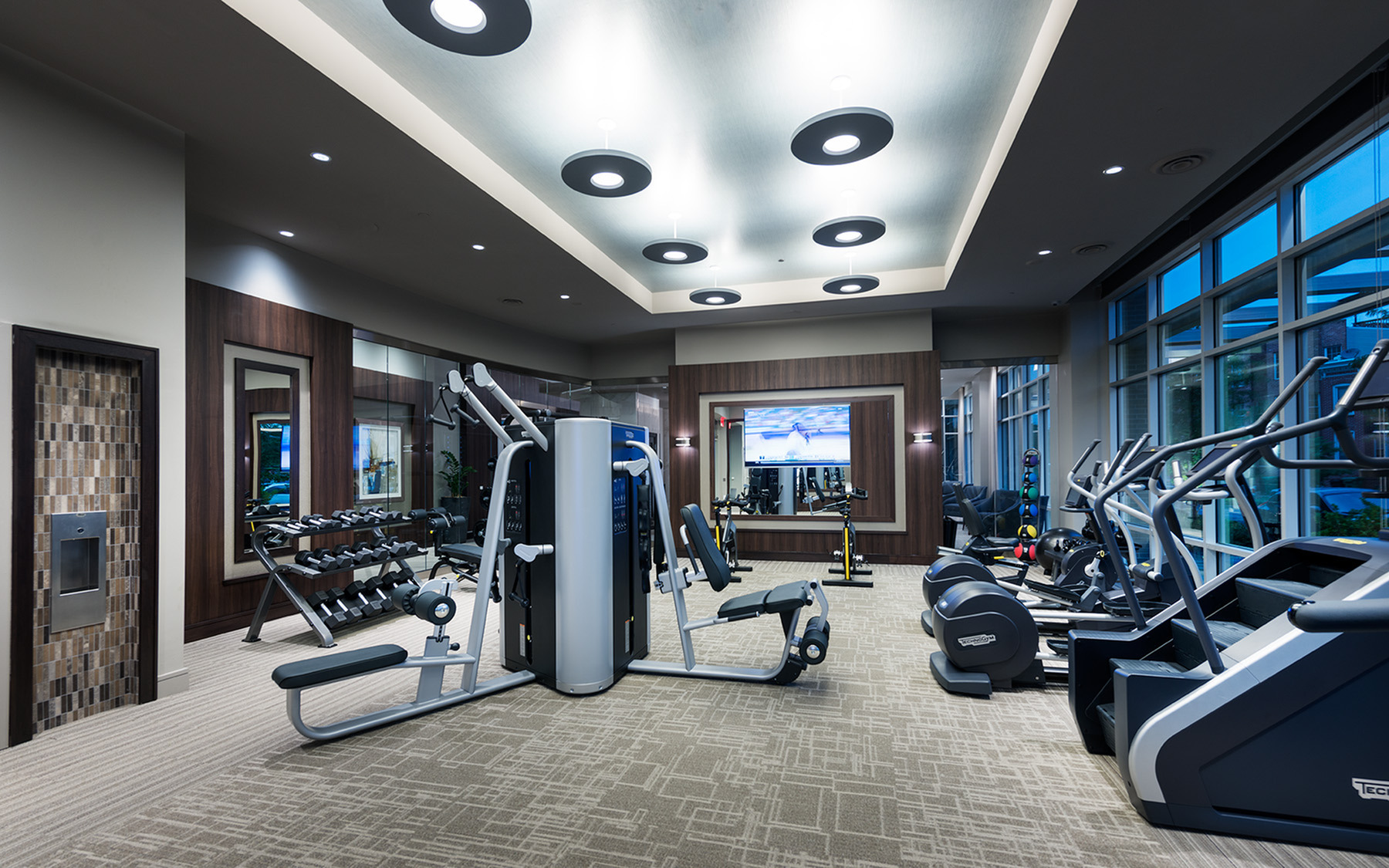 24-hour fitness center with tablet-integrated cardio machines at Hanover Cross Street