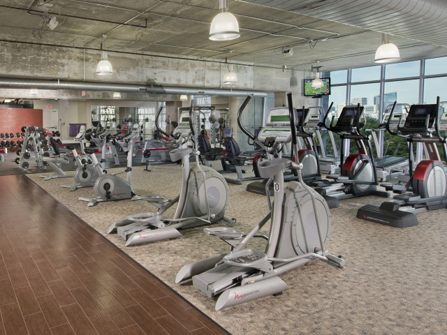 Expansive wellness center with cardio machines at Hanover Hermann Park