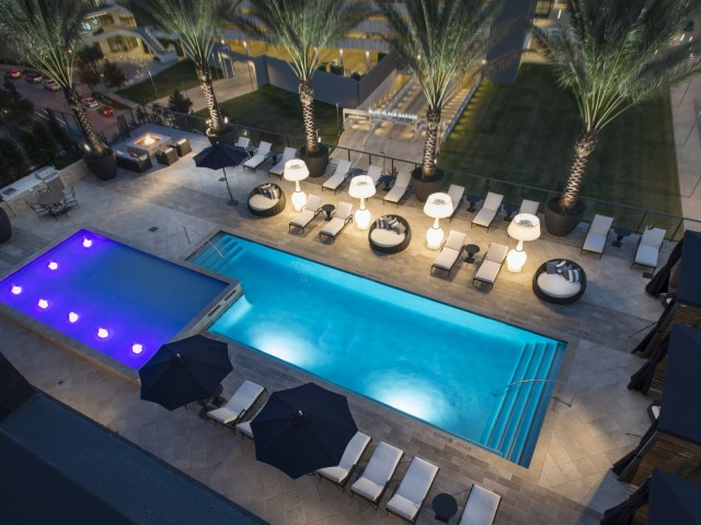 Pool-side private cabanas, luxury lounge seating, grilling stations and fireplaces at Hanover Post Oak