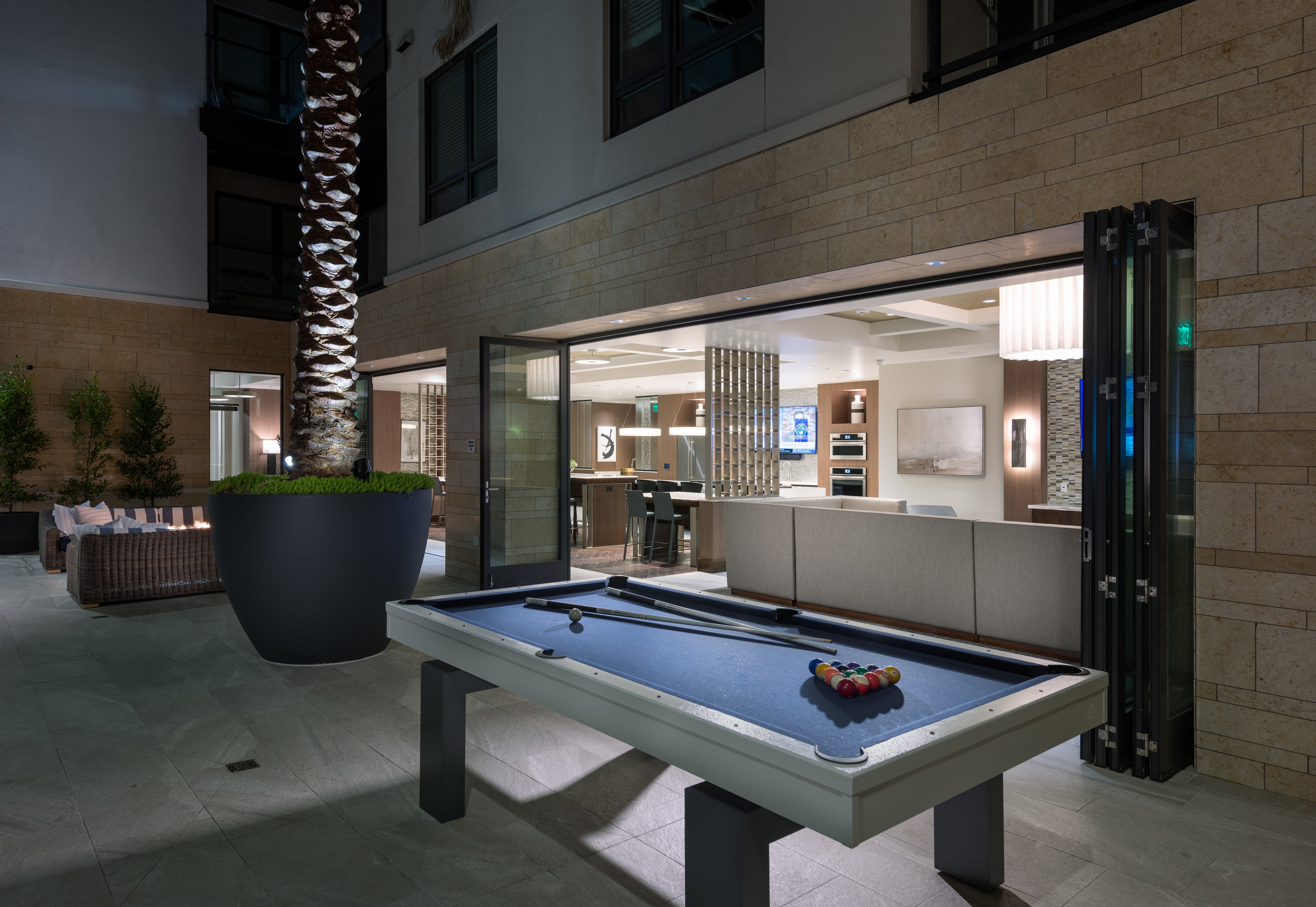 Open-air billiards lounge with outdoor seating, billiards table and firepit at Hanover Northgate