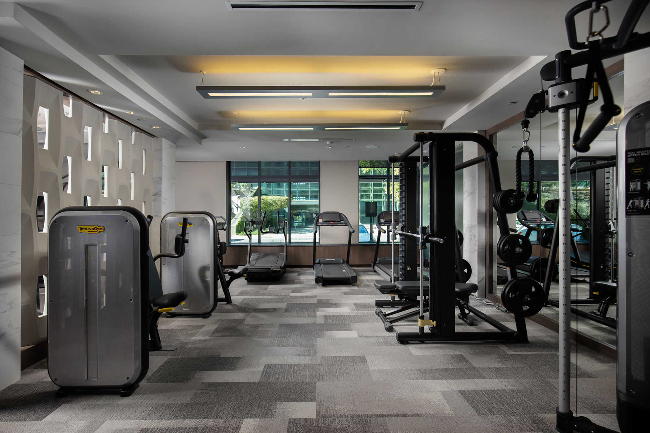 On-site 24-hour fitness center with tablet-integrated cardio machines at Hanover The LINC Brookhaven