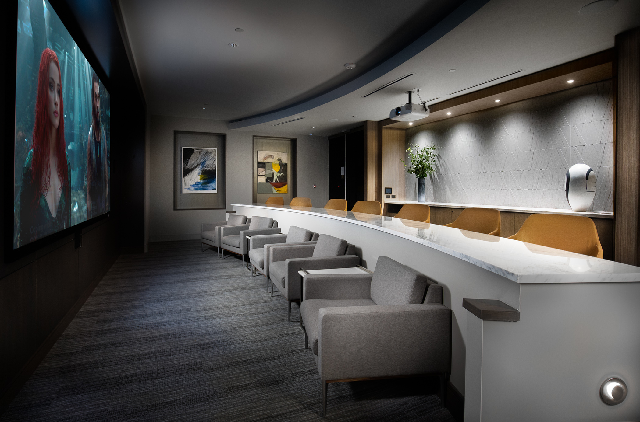 Private screening room featuring theater-style seating at Hanover The LINC Brookhaven
