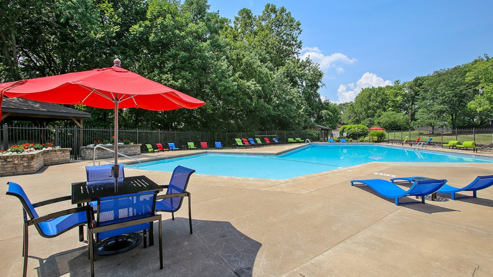 Pool with lounge chairs and umbrellas