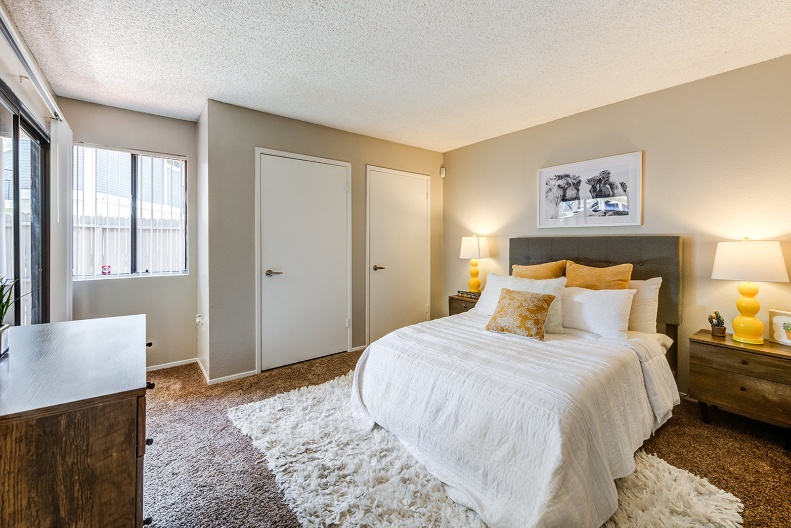 Bedroom with large bed and closets