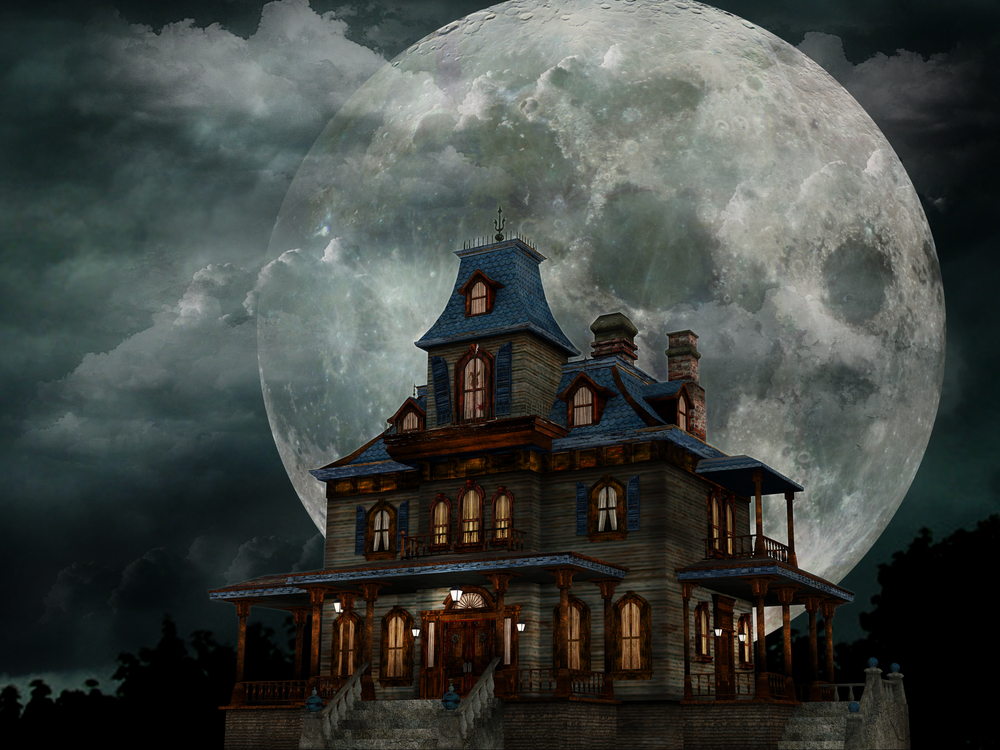 a haunted house in front of a large moon