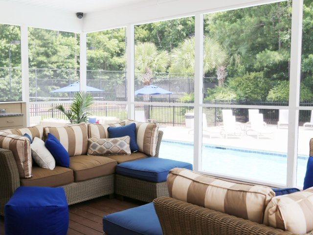 screened in patio overlooking pool