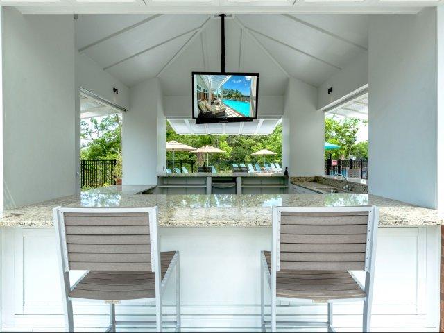 outdoor cabana with tvs