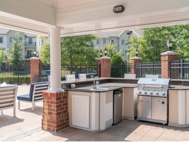 Image of Outdoor Kitchen with Grills and TV for Meridian Parkside