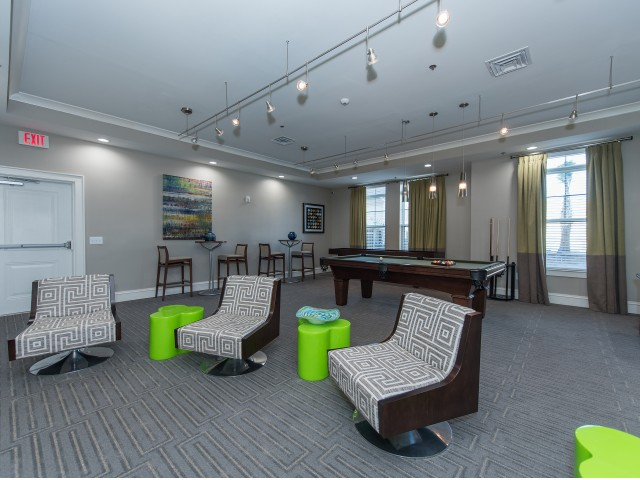 Image of Game room with TV, pool table, shuffleboard and video games for Nexus at Sandhill