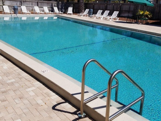 Image of Sparkling Pool with Relaxing Sundeck for Rivercrest Apartments