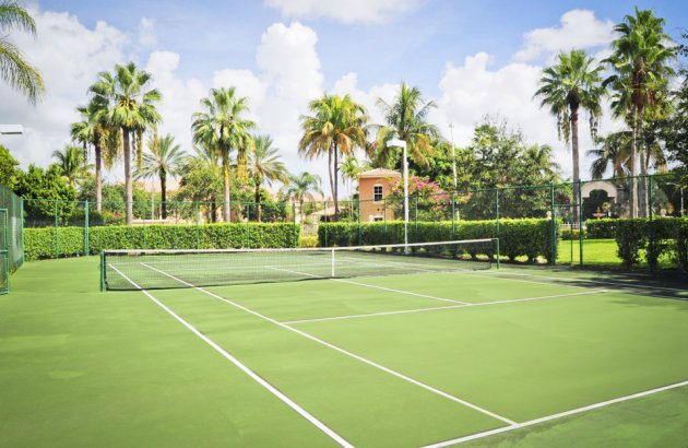 Join friends or neighbors for a game on the lighted tennis court