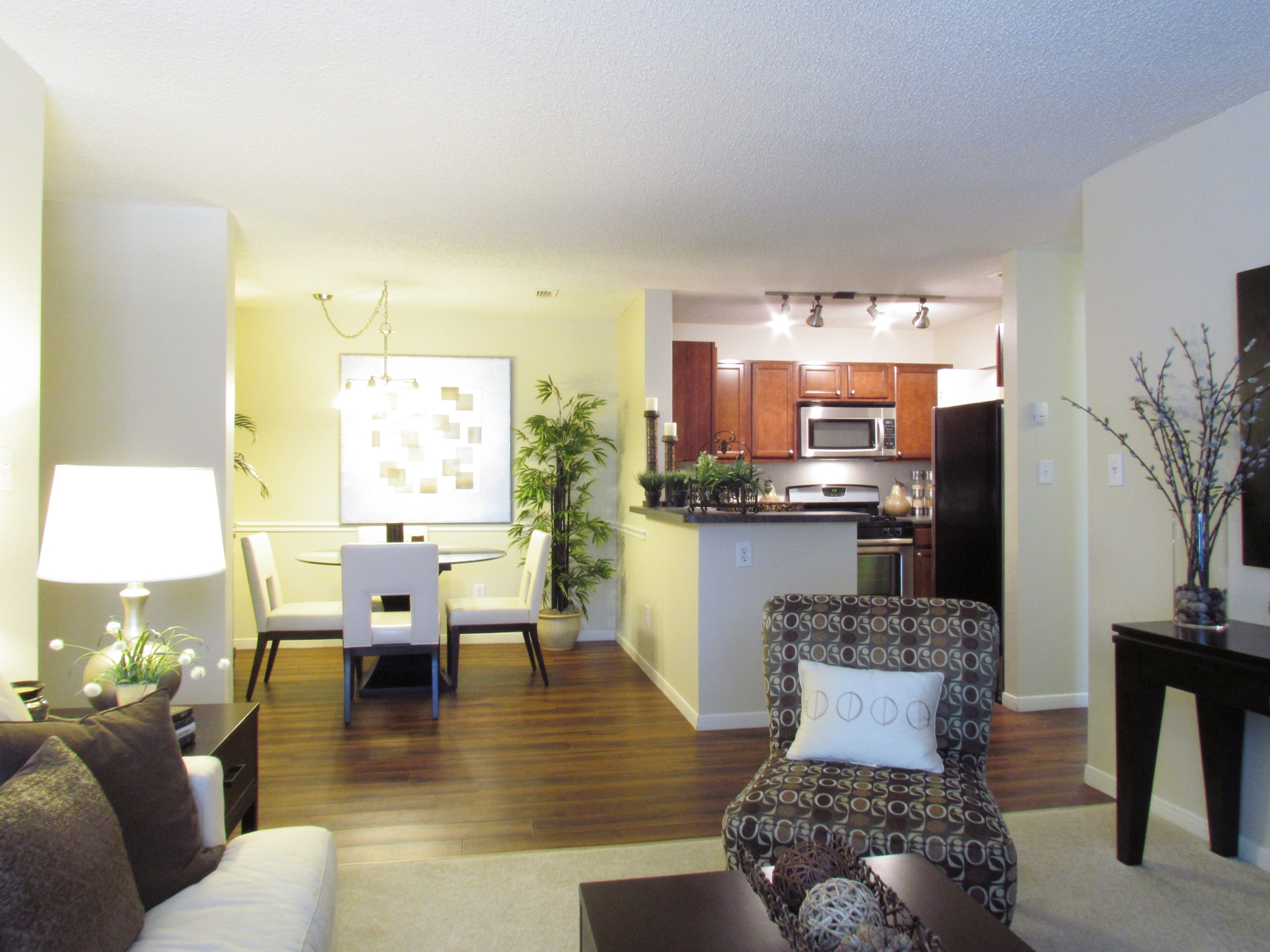 living room and dining room in 2 bedroom Pavilions apartment community