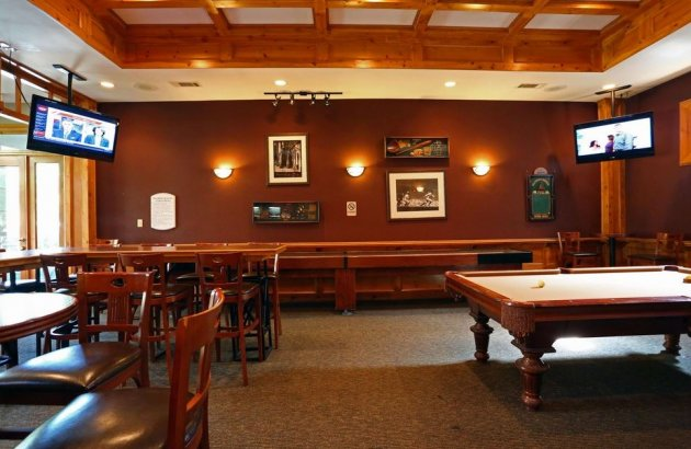Join neighbors and friends for fun in the game room featuring pool, shuffleboard and more