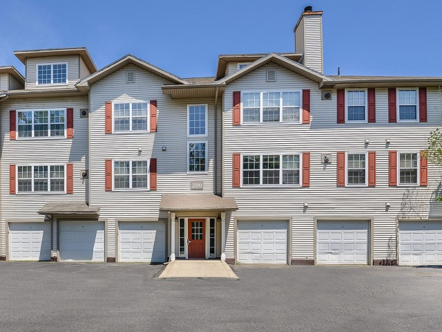 Exterior view of The Residences at Westborough | 3 story townhome rentals with attached garages