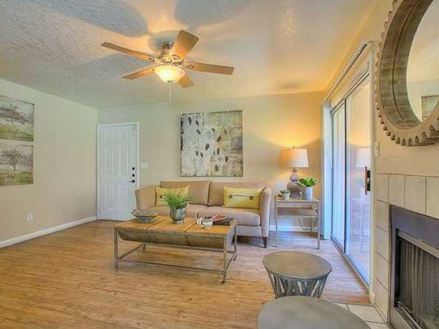 1 bedroom apartment living room | hardwood floors and ceiling fan | sliding door to private patio | Vizcaya rentals