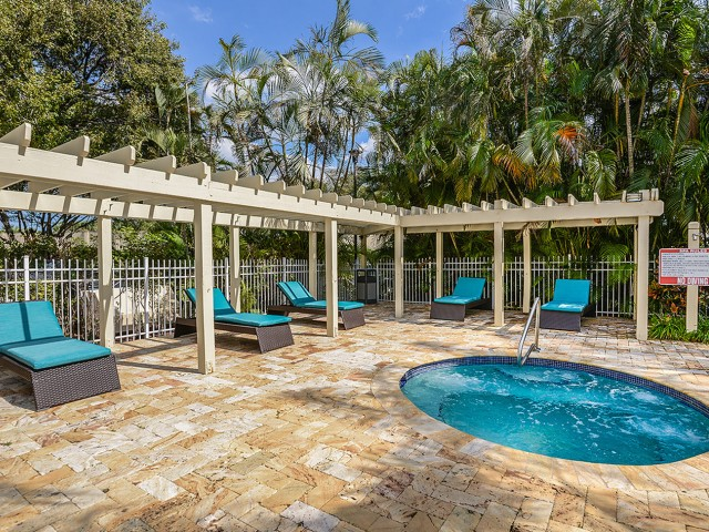 Hot tub with lounge chairs at Windward at the Villages