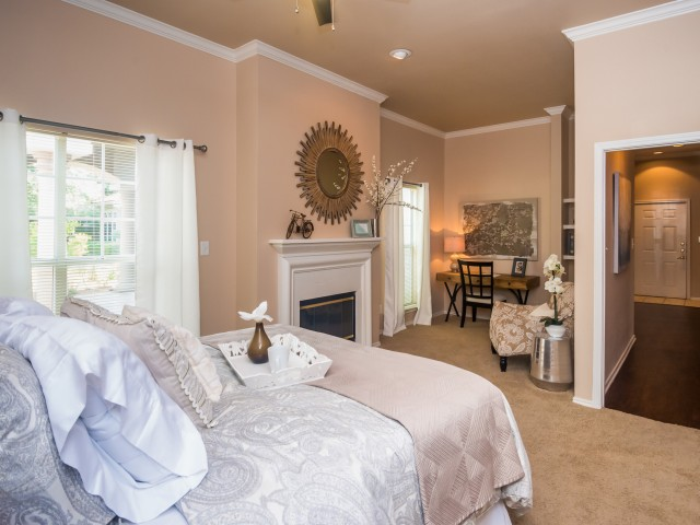 Master bedroom with fireplace and nook | River Stone Ranch 1 bedroom apartment