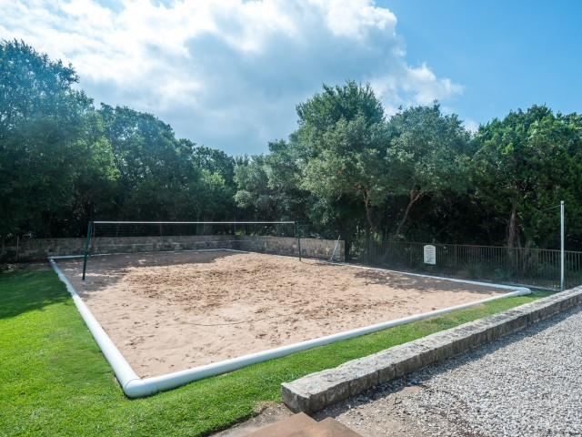 Sand volleyball court at River Stone Ranch apartment complex