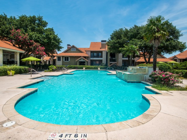 Apartment community pool | Madison at Scofield Farms in Austin