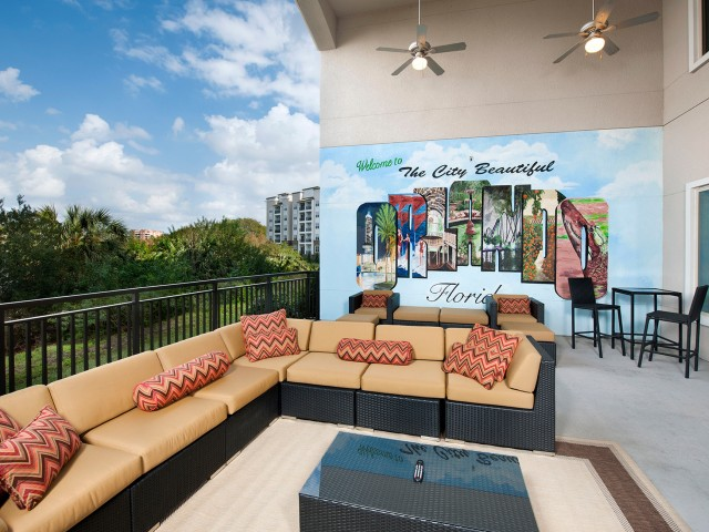 Outdoor patio with seating and tv for residents | Rialto apartments