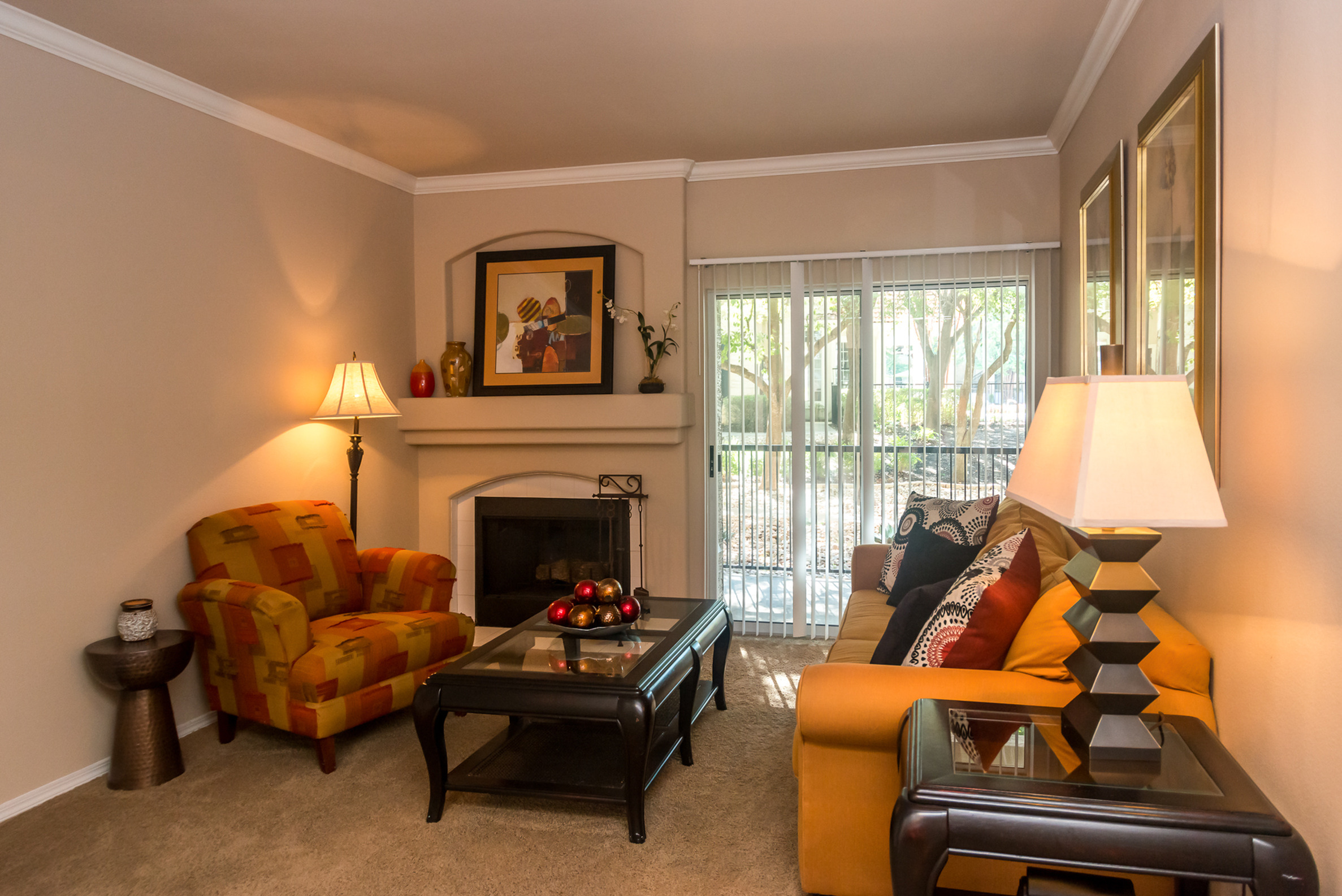 Living room with fireplace | Madison at Wells Branch