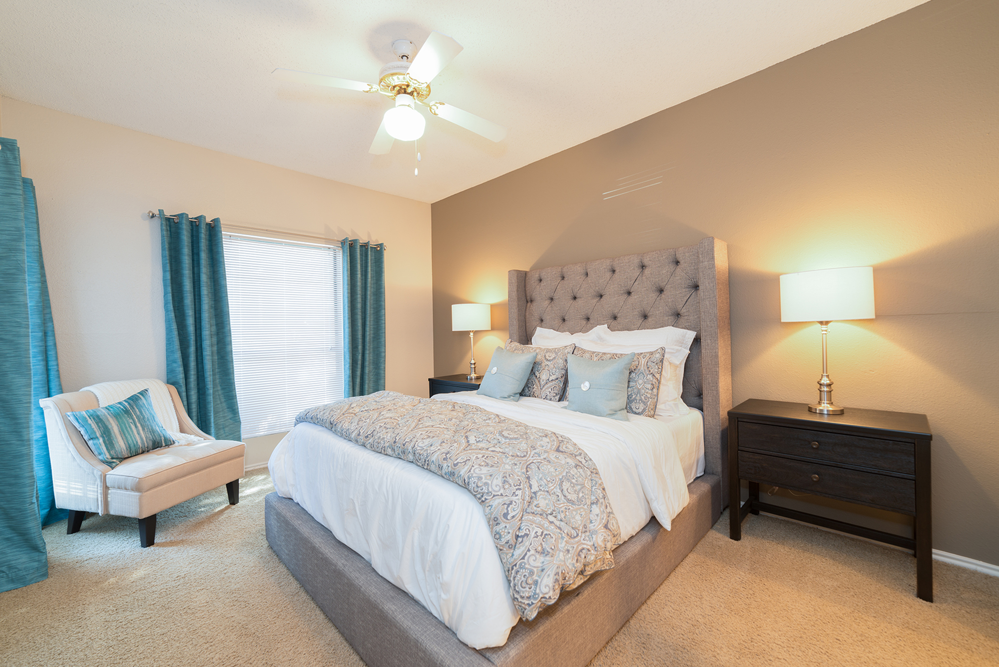 Bedroom with carpeting and ceiling fan | 1 bedroom apartment Canyon Creek in Austin TX