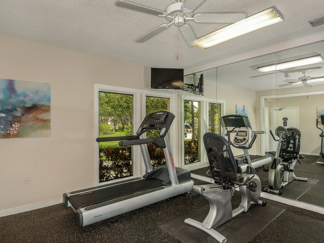 apartment community gym with treadmill and recumbent bike