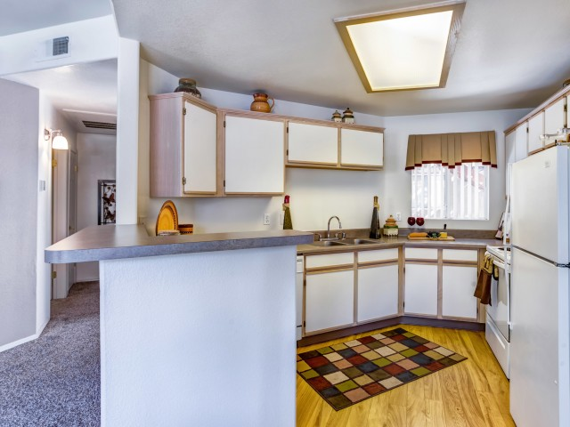Kitchen with white cabinets and appliances | Rio Rancho rental community