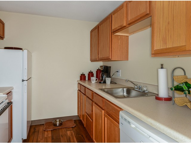 2 bedroom apartment kitchen with light wood cabinets | The Boulders