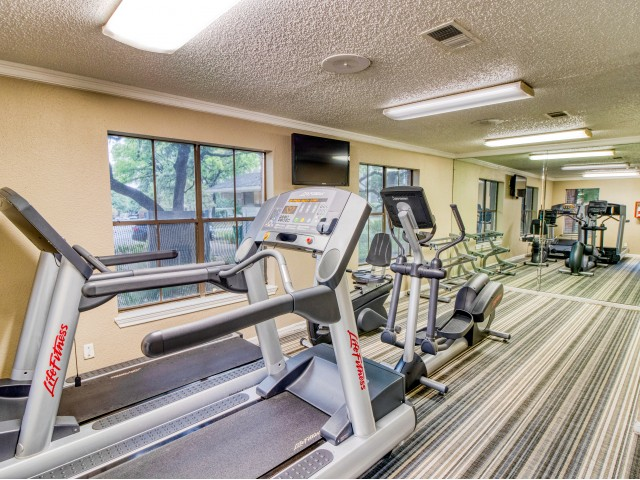Village Oaks apartment fitness center with treadmills